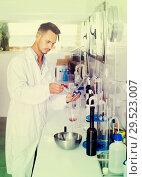 Купить «Attentive young man testing wine qualities», фото № 29523007, снято 19 января 2019 г. (c) Яков Филимонов / Фотобанк Лори