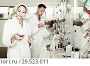 Купить «experts making tests in winery laboratory», фото № 29523011, снято 12 декабря 2019 г. (c) Яков Филимонов / Фотобанк Лори
