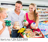 Купить «Attractive family customers choosing yogurt», фото № 29523059, снято 11 июля 2017 г. (c) Яков Филимонов / Фотобанк Лори