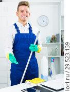 Купить «Man doing professional clean-up», фото № 29523139, снято 25 мая 2019 г. (c) Яков Филимонов / Фотобанк Лори