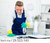 Купить «Cheerful male janitor doing clean-up», фото № 29523143, снято 15 декабря 2018 г. (c) Яков Филимонов / Фотобанк Лори