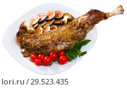 Купить «Tasty baked shoulder of lamb with cherry tomatoes, fig, feta cheese and herbs», фото № 29523435, снято 14 октября 2019 г. (c) Яков Филимонов / Фотобанк Лори