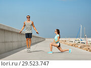 Купить «happy couple warming up on pier before training», фото № 29523747, снято 1 августа 2018 г. (c) Syda Productions / Фотобанк Лори