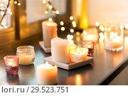 Купить «candles burning on window sill with garland lights», фото № 29523751, снято 13 января 2018 г. (c) Syda Productions / Фотобанк Лори
