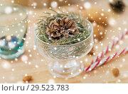 Купить «christmas fir decoration with cone in dessert bowl», фото № 29523783, снято 15 ноября 2017 г. (c) Syda Productions / Фотобанк Лори