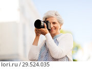 Купить «senior woman photographing by digital camera», фото № 29524035, снято 3 августа 2018 г. (c) Syda Productions / Фотобанк Лори