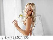 Купить «woman in underwear smelling flower at window», фото № 29524135, снято 20 апреля 2017 г. (c) Syda Productions / Фотобанк Лори