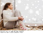 Купить «sad girl sitting on sill at home window in winter», фото № 29524167, снято 5 ноября 2016 г. (c) Syda Productions / Фотобанк Лори