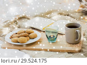 Купить «cookies, tea and candle at home over snow», фото № 29524175, снято 15 ноября 2017 г. (c) Syda Productions / Фотобанк Лори