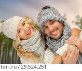 Купить «couple hugging over winter forest background», фото № 29524251, снято 7 октября 2012 г. (c) Syda Productions / Фотобанк Лори