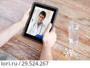 Купить «patient having video chat with doctor on tablet pc», фото № 29524267, снято 14 мая 2015 г. (c) Syda Productions / Фотобанк Лори