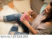 Купить «happy woman eating popcorn at home», фото № 29524283, снято 13 января 2018 г. (c) Syda Productions / Фотобанк Лори