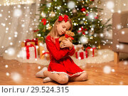 Купить «girl in red dress hugging teddy bear at home», фото № 29524315, снято 22 декабря 2017 г. (c) Syda Productions / Фотобанк Лори