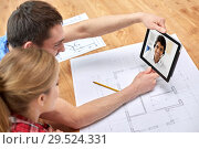 Купить «couple having video call with architect», фото № 29524331, снято 26 января 2014 г. (c) Syda Productions / Фотобанк Лори