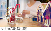 Купить «close up of candy canes and gingerbread houses», фото № 29524351, снято 30 октября 2014 г. (c) Syda Productions / Фотобанк Лори
