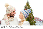 Купить «happy couple over christmas tree in tallinn», фото № 29524359, снято 3 октября 2015 г. (c) Syda Productions / Фотобанк Лори