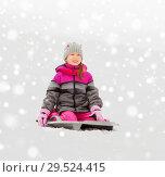 Купить «happy little girl on sled outdoors in winter», фото № 29524415, снято 10 февраля 2018 г. (c) Syda Productions / Фотобанк Лори