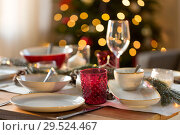 Купить «table setting for christmas dinner at home», фото № 29524467, снято 14 декабря 2017 г. (c) Syda Productions / Фотобанк Лори