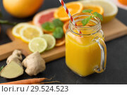 Купить «mason jar glass of fruit juice on slate table top», фото № 29524523, снято 4 апреля 2018 г. (c) Syda Productions / Фотобанк Лори