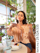Купить «woman photographing food by smartphone at cafe», фото № 29524535, снято 7 августа 2018 г. (c) Syda Productions / Фотобанк Лори