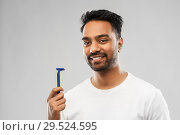 Купить «indian man shaving beard with razor blade», фото № 29524595, снято 27 октября 2018 г. (c) Syda Productions / Фотобанк Лори