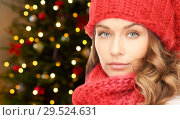Купить «woman in hat and scarf over christmas lights», фото № 29524631, снято 10 октября 2010 г. (c) Syda Productions / Фотобанк Лори