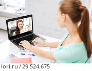woman or student having video call on laptop. Стоковое фото, фотограф Syda Productions / Фотобанк Лори