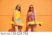 Купить «teenage girls with short skateboards outdoors», фото № 29524743, снято 19 июля 2018 г. (c) Syda Productions / Фотобанк Лори