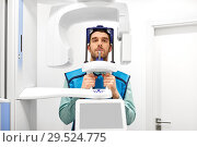 Купить «patient having x-ray scanning at dental clinic», фото № 29524775, снято 22 апреля 2018 г. (c) Syda Productions / Фотобанк Лори