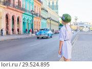 Купить «Little girl in popular area near El Capitolio in Havana City, Cuba. Portrait of kid background vintage classic american car», фото № 29524895, снято 14 апреля 2017 г. (c) Дмитрий Травников / Фотобанк Лори