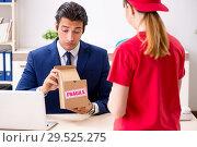 Купить «Courier delivering parcel to the office», фото № 29525275, снято 5 июля 2018 г. (c) Elnur / Фотобанк Лори