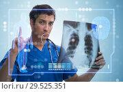Купить «Doctor looking at x-ray image in telehealth concept», фото № 29525351, снято 26 марта 2019 г. (c) Elnur / Фотобанк Лори