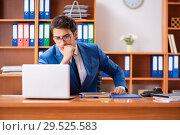 Купить «Young employee working in the office», фото № 29525583, снято 9 августа 2018 г. (c) Elnur / Фотобанк Лори