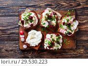 Купить «Smorrebrod with fish on a board», фото № 29530223, снято 1 декабря 2018 г. (c) Oksana Zh / Фотобанк Лори