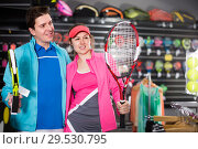 Купить «female with male are standing in sportwear with new racket for padel and tennis in the speciality store», фото № 29530795, снято 7 февраля 2018 г. (c) Яков Филимонов / Фотобанк Лори