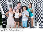 Купить «Parents with their children are satisfied after visit of escape room», фото № 29530815, снято 3 августа 2017 г. (c) Яков Филимонов / Фотобанк Лори