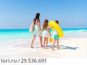 Купить «Adorable little girls and young mother on white beach.», фото № 29536691, снято 9 апреля 2017 г. (c) Дмитрий Травников / Фотобанк Лори