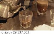 Купить «Brewing freshly roasted and ground coffee beans for sponging stock footage video», видеоролик № 29537363, снято 6 декабря 2018 г. (c) Юлия Машкова / Фотобанк Лори
