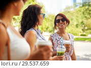 Купить «happy women or friends with drinks at summer park», фото № 29537659, снято 22 июля 2018 г. (c) Syda Productions / Фотобанк Лори