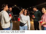 Купить «friends with drinks dancing at rooftop party», фото № 29537699, снято 2 сентября 2018 г. (c) Syda Productions / Фотобанк Лори
