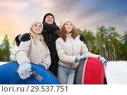 Купить «happy friends with snow tubes outdoors in winter», фото № 29537751, снято 19 января 2015 г. (c) Syda Productions / Фотобанк Лори