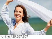 Купить «happy woman with shawl waving in wind on beach», фото № 29537807, снято 15 июня 2018 г. (c) Syda Productions / Фотобанк Лори