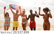 friends at american independence day beach party. Стоковое фото, фотограф Syda Productions / Фотобанк Лори