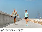 Купить «happy couple warming up on pier before training», фото № 29537919, снято 1 августа 2018 г. (c) Syda Productions / Фотобанк Лори