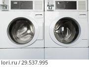 Купить «washing machines at laundromat», фото № 29537995, снято 20 марта 2019 г. (c) Syda Productions / Фотобанк Лори