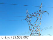 Купить «transmission tower and power line over blue sky», фото № 29538007, снято 3 марта 2018 г. (c) Syda Productions / Фотобанк Лори