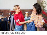 Купить «happy women with coffee at vintage clothing store», фото № 29538267, снято 7 августа 2018 г. (c) Syda Productions / Фотобанк Лори
