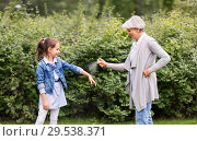 Купить «grandma and granddaughter with insect repellent», фото № 29538371, снято 11 августа 2018 г. (c) Syda Productions / Фотобанк Лори
