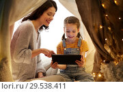 Купить «family with tablet pc in kids tent at home», фото № 29538411, снято 27 января 2018 г. (c) Syda Productions / Фотобанк Лори