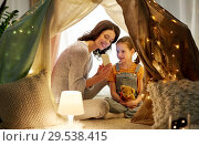Купить «happy family with smartphone in kids tent at home», фото № 29538415, снято 27 января 2018 г. (c) Syda Productions / Фотобанк Лори